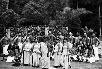 Black and white picture of a Tahitian group of dancers called Temaeva with traditional clothes and in front of a marae